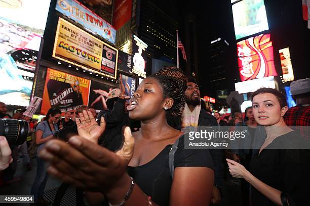 Protesters chant slogans as they march from Union Square to Times Square to protest a grand jury's decision not to indict a Ferguson police officer...
