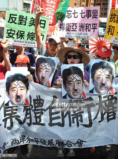 Protesters chant slogans display Japanese military flags and portraits of Prime Minister Shinzo Abe and a protest sign read like Don't forget Marco...