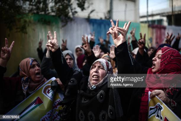 Protesters chant slogans during a protest against US decision to suspend financial aid earmarked for the UN Relief and Works Agency which is...