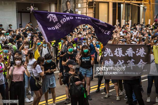 Protesters chant slogans during a rally against a new national security law in Hong Kong on July 1 on the 23rd anniversary of the city's handover...