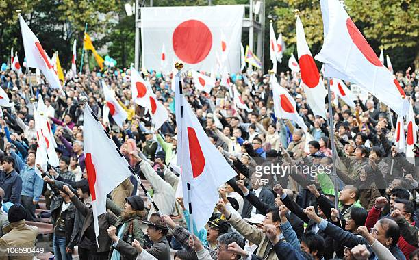 Protesters chant slogans during an antiChina protest rally in central Tokyo on November 6 2010 Japanese national flags fluttered as more than 3500...