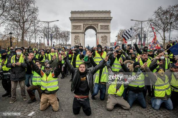 Protesters chant slogans during the 'yellow vests' demonstration on the Champs-Elysées near the Arc de Triomphe on December 8, 2018 in Paris France....