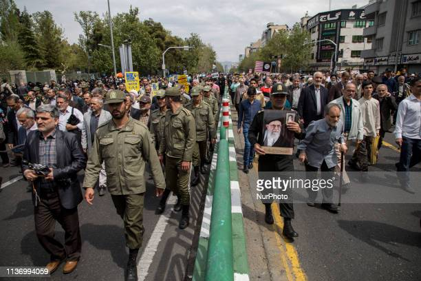 Protesters chant slogans in a rally against the US's decision to designate Iran's powerful Revolutionary Guards as a foreign terrorist organization...