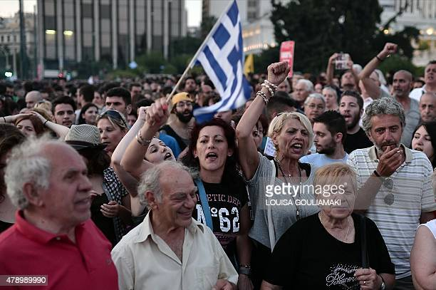Protesters chant slogans in front of the Greek parliament in central Athens on June 29 2015 Some 17000 people took to the streets of Athens and...