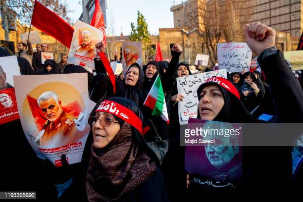 Protesters chant slogans while holding up posters of Gen. Qassem Soleimani during a demonstration in front of the British Embassy on January 12, 2020...