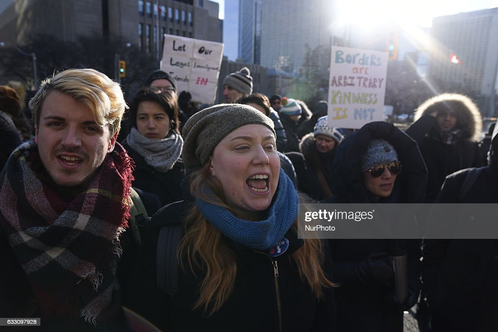 Demonstrators Protest President Trump's Travel Ban Outside Of The U.S. Consulate : News Photo