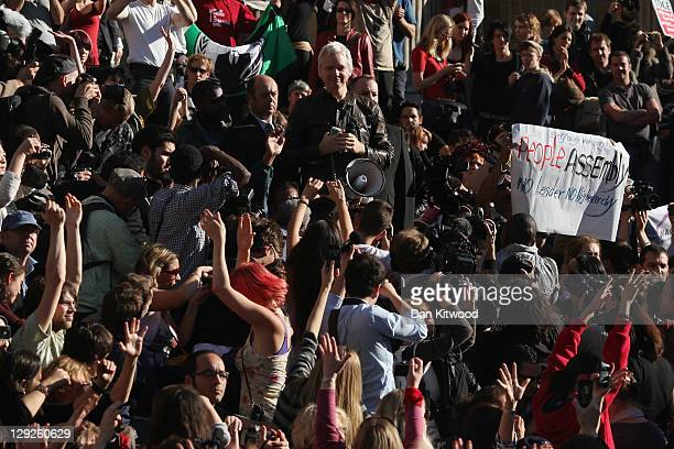 Protesters cheer as Julian Assange the founder of the WikiLeaks website speaks outside St Paul's Cathedral during the 'Occupy London' protest on...