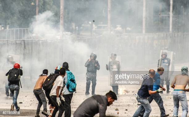 Protesters clash with Bolivarian National Police near the Paramacay Fort in Valencia Venezuela on August 06 2017 Two assailants were killed and eight...
