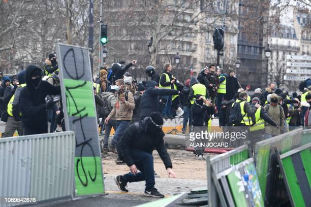 Protesters clash with French riot police during an antigovernment demonstration called by the Yellow Vests Gilets Jaunes movement in Paris on January...