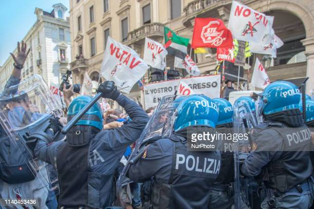 Protesters clash with Italian riot police officers during the celebration of May Day in Turin Italy on 1st May 2019