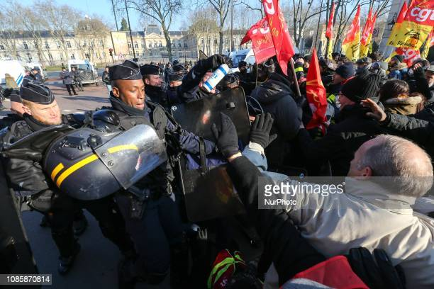 Protesters clash with members of the French antiriot police CRS in the streets of Versailles outside Paris on January 21 during a rally called by the...
