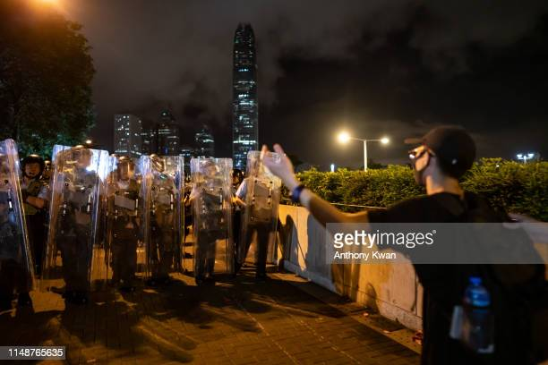 Protesters clash with police after a rally against the extradition law proposal at the Central Government Complex on June 9 2019 in Hong Kong...