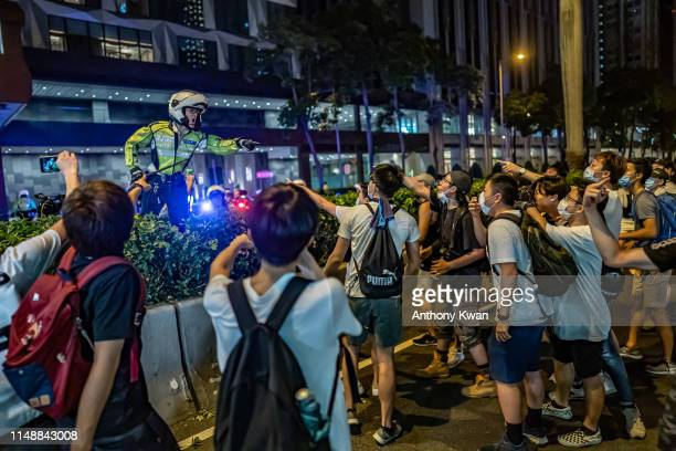 Protesters clash with police after a rally against the extradition law proposal at the Central Government Complex on June 10 2019 in Hong Kong China...