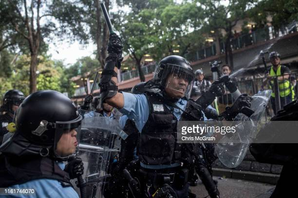 Protesters clash with police after taking part in a march against mainland Chinese parallel traders in the Sheung Shui district on July 13 2019 in...