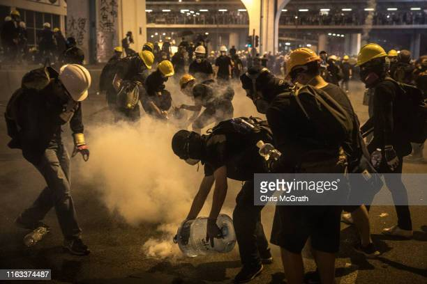 Protesters clash with police after taking part in an antiextradition bill march on July 21 2019 in Hong Kong China Prodemocracy protesters have...