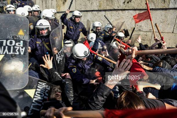 Protesters clash with police after the end of a protest against new reforms planned by the government concerning property auctions and labor strikes...