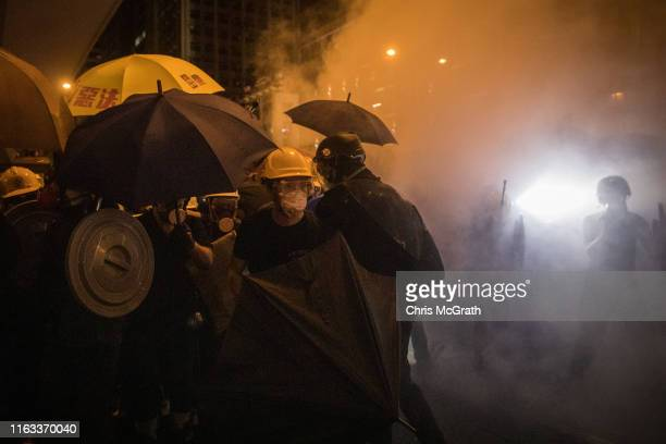 Protesters clash with police amid tear gas after taking part in an antiextradition bill march on July 21 2019 in Hong Kong China Prodemocracy...