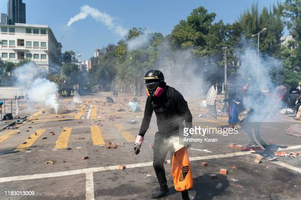 Protesters clash with police as police fire teargas at them at the Hong Kong Poytechnic University on November 17 2019 in Hong Kong China...
