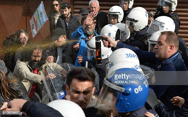 TOPSHOT Protesters clash with police as they gather outside the premises of the construction holding which wants to build a gold mine in the Black...