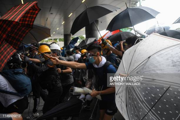 TOPSHOT Protesters clash with police during a demonstration outside the Legislative Council Complex in Hong Kong on June 12 2019 Violent clashes...