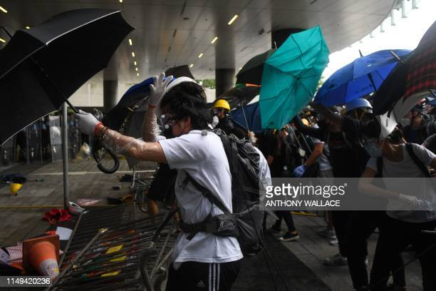 Protesters clash with police during a demonstration outside the Legislative Council Complex in Hong Kong on June 12 2019 Violent clashes broke out in...