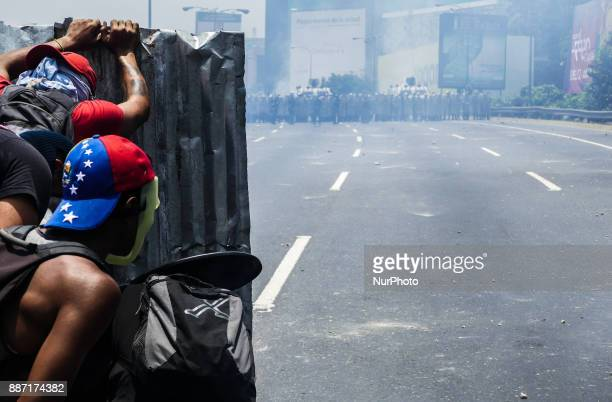 Protesters clash with police during a demonstration to the streets of Caracas Venezuela on November 30 2017 to protest against the country's lack of...