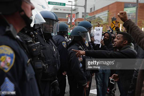 Protesters clash with police during a march in honor of Freddie Gray on April 25 2015 in Baltimore Maryland Gray was arrested for possessing a switch...