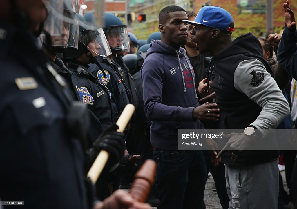 Protesters clash with police during a march in honor of Freddie Gray on April 25, 2015 in Baltimore, Maryland. Gray, 25, was arrested for possessing a switch blade knife outside the Gilmor Homes housing project on Baltimore's west side on April 12. According to his attorney, Gray died a week later in the hospital from a severe spinal cord injury he received while in police custody.
