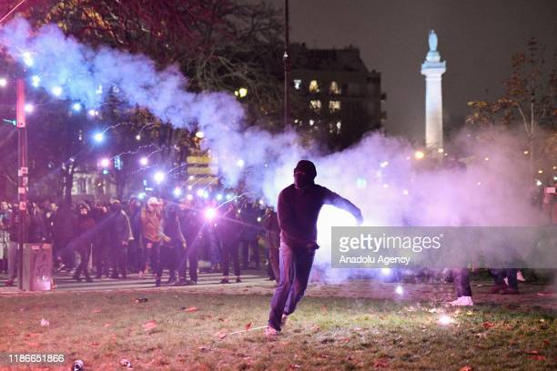 Protesters clash with police during a protest against President Emmanuel Macron's controversial pension plans and in support of the national strike...