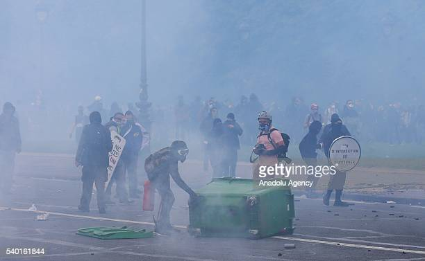 Protesters clash with police during a protest against the new labor law also known as the El Khomri law which has recently proposed by Labor Minister...