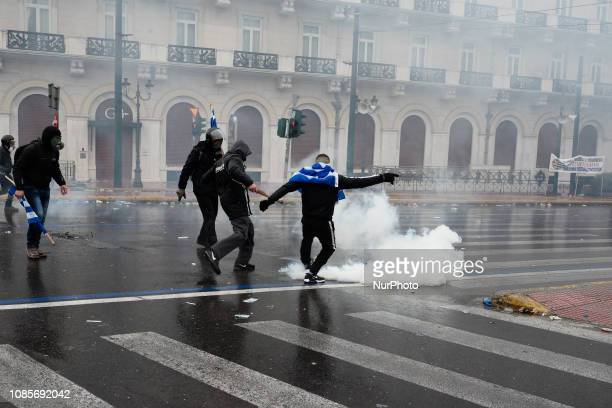 Protesters clash with police during a rally over Macedonia name row in Syntagma square central Athens on January 20 2019 Violent clashes broke out...