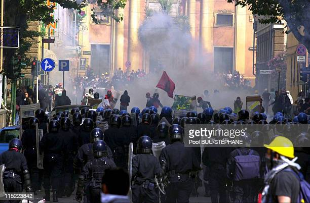 Protesters clash with police during protests against the 27th Group of Eight Summit on July 20 2001 in Genoa Italy Hundreds of thousands of...