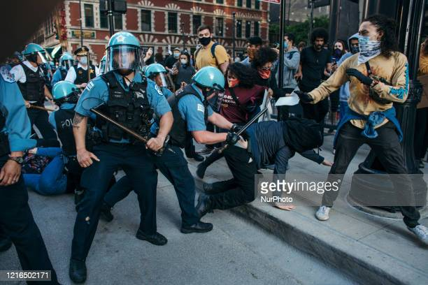 Protesters clash with police in Chicago on May 30 2020 during a protest against the death of George Floyd an unarmed black man who died while while...