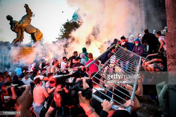TOPSHOT Protesters clash with police in front of Serbia's National Assembly building in Belgrade on July 8 2020 during a demonstration against a...