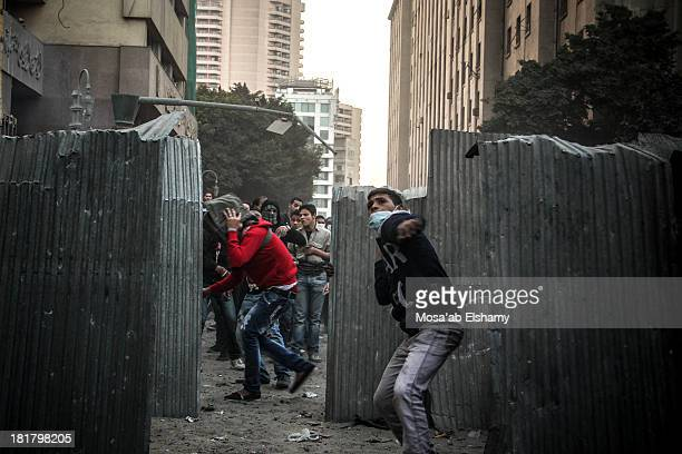 Protesters clash with police near Tahrir square on second anniversary of revolution