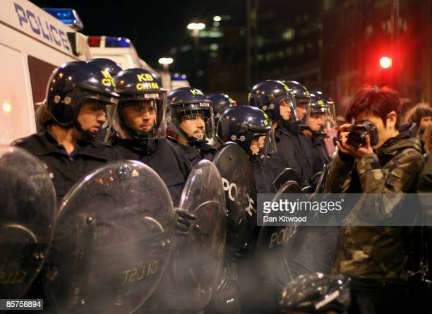 Protesters clash with police near the RBS headquarters as anti capitalist and climate change activists demonstrate in the City of London on April 1...