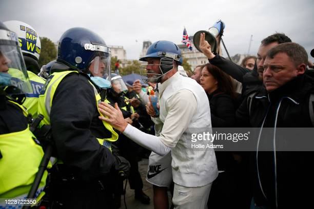 "Protesters clash with police officers during a ""We Do Not Consent"" anti-mask rally at Trafalgar Square on September 26, 2020 in London, England...."