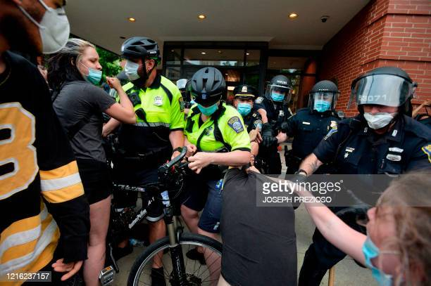 Protesters clash with police officers outside the District Four Police station during a Black Lives Matter protest against police brutality and...