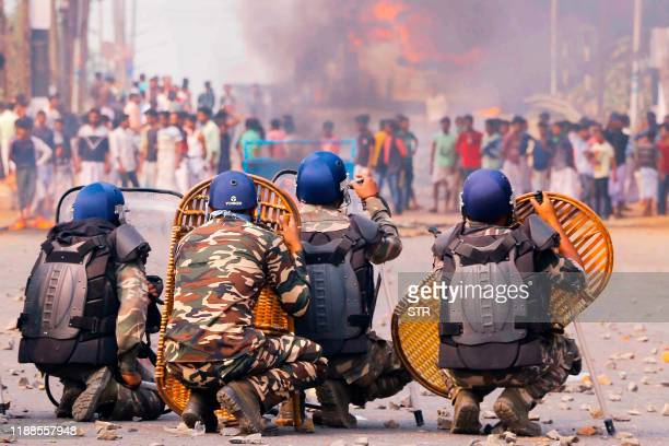 Protesters clash with police on a road during a demonstration against the Indian government's Citizenship Amendment Bill in Howrah, on the outskirts...