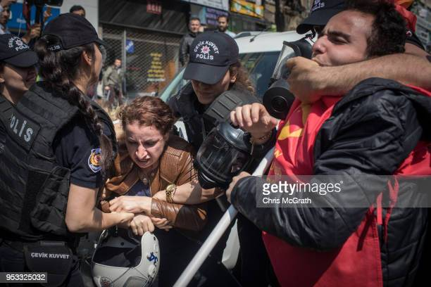 Protesters clash with police on a street in the Besiktas neighbourhood during a May Day demonstration on May 1 2018 in Istanbul Turkey People...