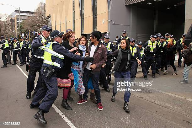Protesters clash with police outside as Prime Minister Tony Abbott opens the Peter Doherty Institute for Infection and Immuminty facility on...