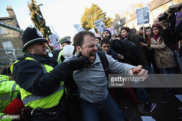 Protesters clash with police outside Cambridge University's Student Union as Marine Le Pen the leader of the French farright 'Front National' party...