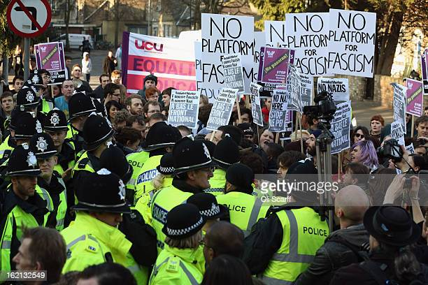 Protesters clash with police outside Cambridge University's Student Union as Marine Le Pen, the leader of the French far-right 'Front National'...
