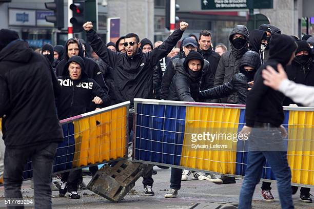 Protesters clash with riot police after a peaceful gathering was disrupted by right-wing demonstrators on March 27, 2016 in Brussels, Belgium. The...
