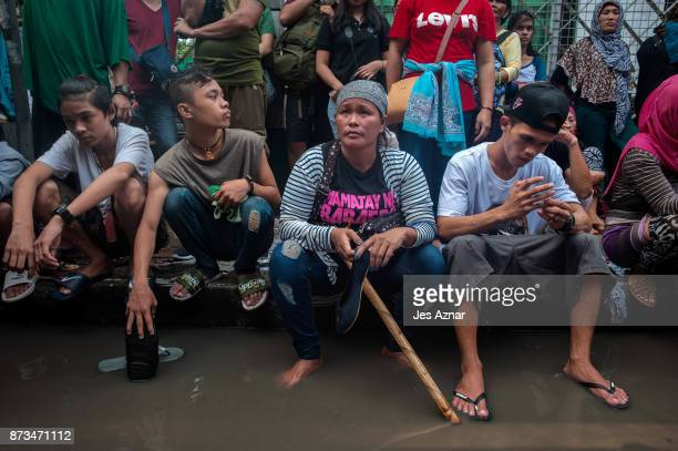 Protesters clash with riot police as they march the streets of Manila during the start of the ASEAN meetings between heads of state on November 13...