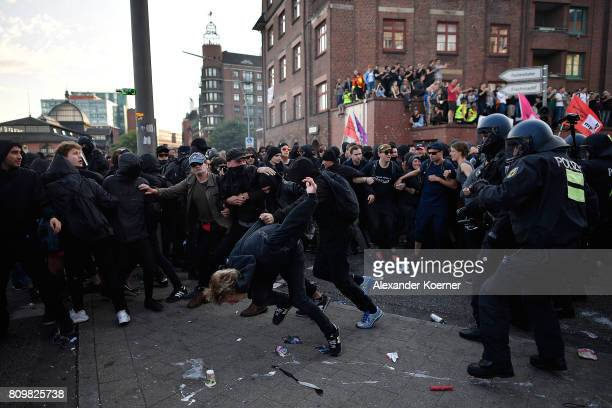 """Protesters clash with riot police as they take part in the """"Welcome to Hell"""" protest march on July 6, 2017 in Hamburg, Germany. Leaders of the G20..."""