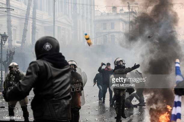 Protesters clash with riot police during a demonstration against the agreement with Skopje to rename neighbouring country Macedonia as the Republic...