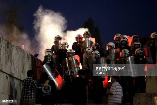 Protesters clash with riot police during a demonstration against the agreement between Greece and FYROM outside the Greek Parliament in Athens Greece...