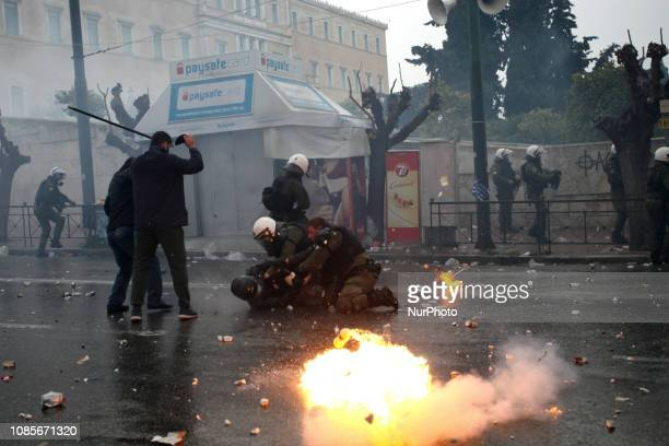 Protesters clash with riot police during a demonstration in Syntagma square against the agreement between Athens and Skopje regarding the name...