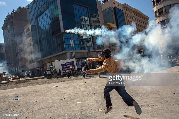 Protesters clash with riot police during a demonstration near Taksim Square on June 11 2013 in Istanbul Turkey Istanbul has seen protests rage on for...